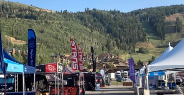 brand tents in rows with mountains in background
