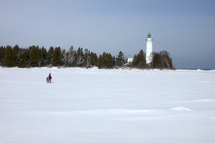 adult and child walking to lighthouse in Door County