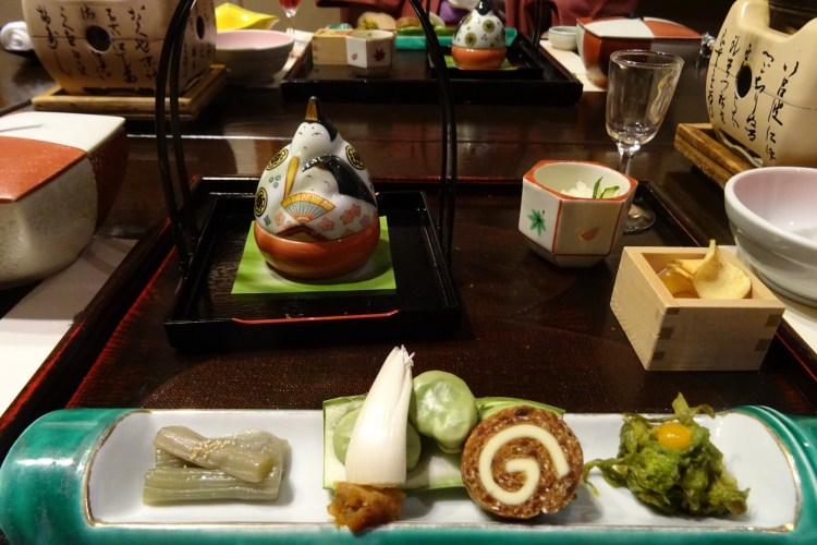 food ornamented on a tray with tea kettle