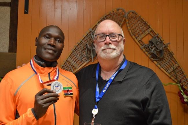 Mark Elmore & Abraham Kosgei posting at 2020 us snowshoe championships