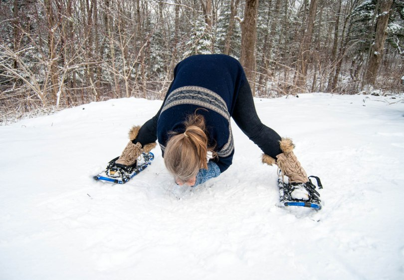 Wide forward fold, yoga outside in the snow