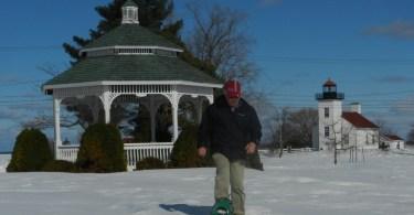 man snowshoeing from gazebo in Ludington Park