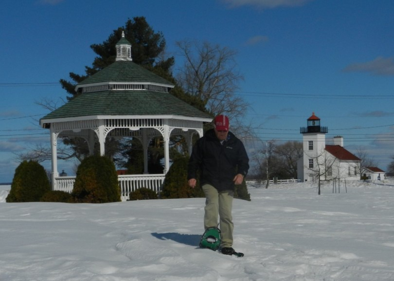 snowshoeing Escanaba in Michigan Upper Peninsula: man snowshoeing from gazebo in Ludington Park