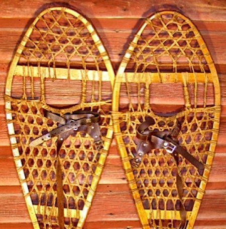 Huron wooden snowshoes resting on the wood surface
