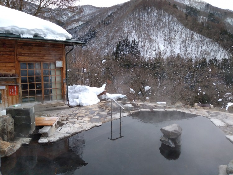 hot spring and changing room with mountain view