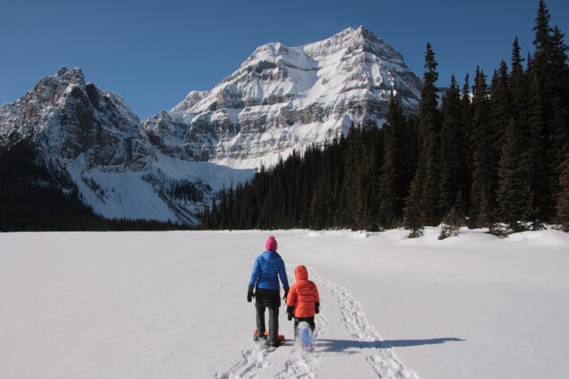 mom and son snowshoeing in Canadian Rockies, choose your trail