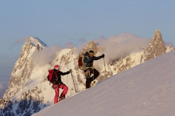 snowshoers ascending a steep hill with Lightning Ascent snowshoes