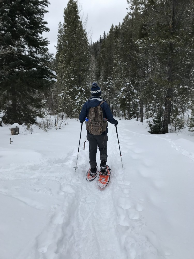 man snowshoeing with Northern Lites Backcountry snowshoes at Monarch Lake CO