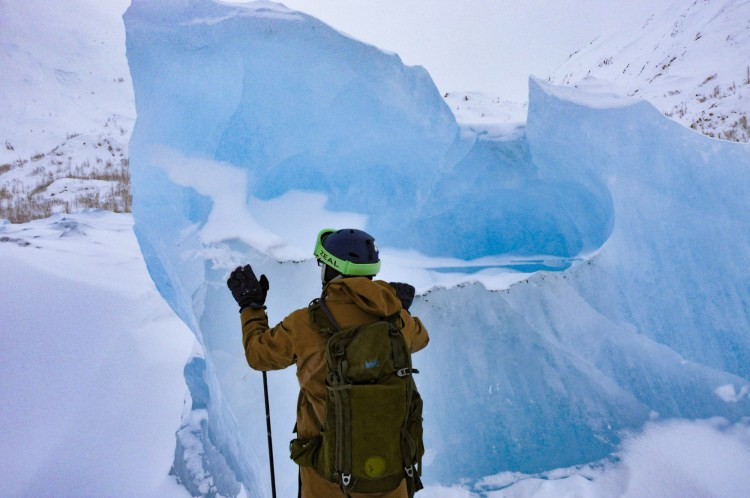 dying glacier: man looking out from top of Portage Glacier
