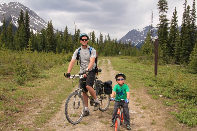 son and dad posed for a photo while biking to Watridge Lake