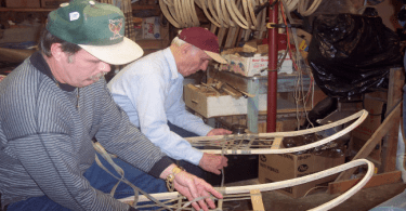 Brian and Edmond Theriault making wooden snowshoes