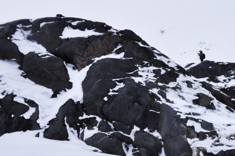 rock outcrop covered in snow