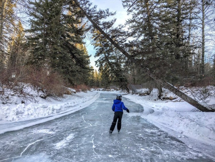 outdoor winter activities idea: woman ice skating in a park