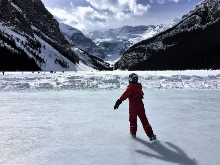 child ice skating on Lake Louise AB
