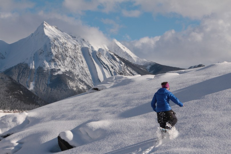 using snowshoes in deep powder