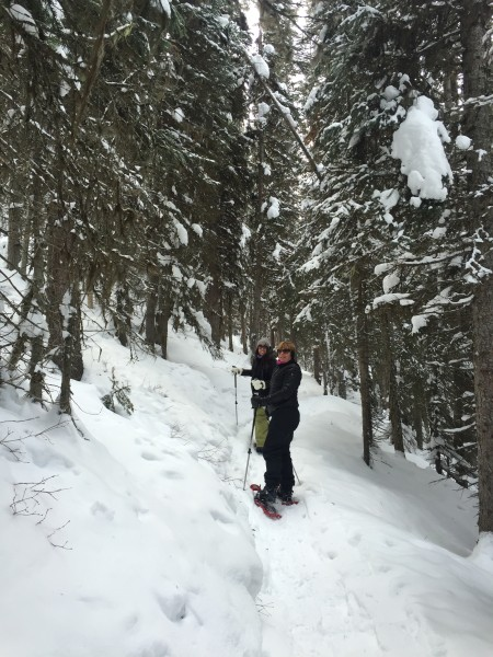 mom and daughter snowshoeing