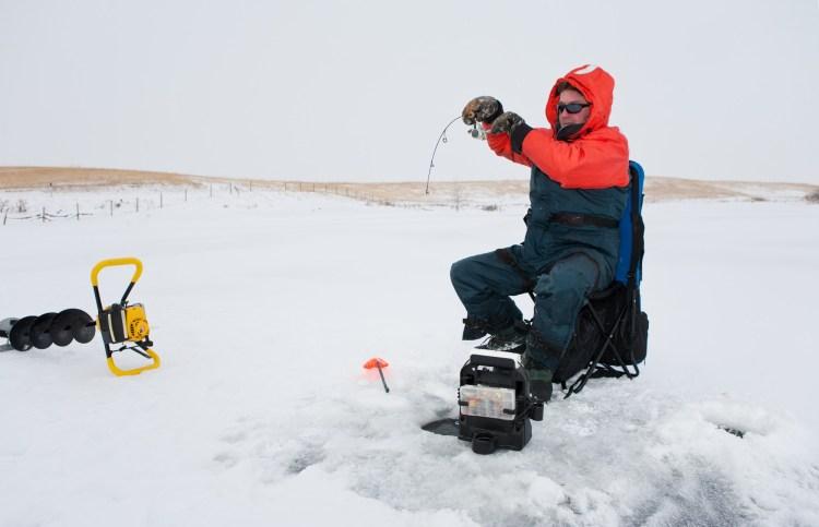 man fishing in winter
