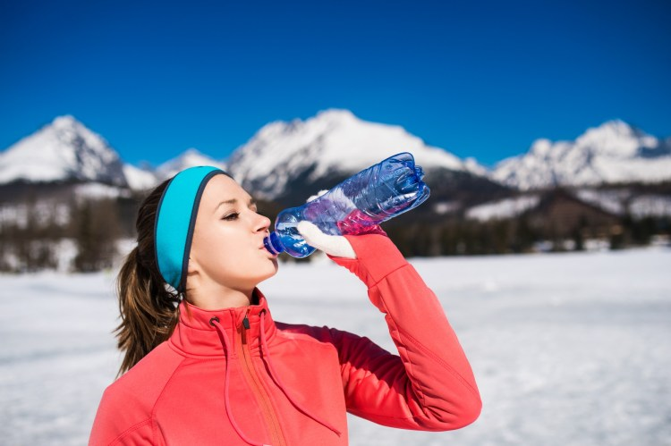 woman in winter with water bottle