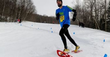 runner using TSL snowshoes