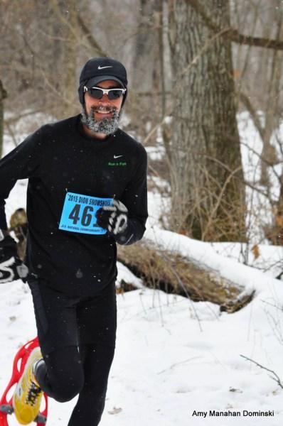 Genial Eric Hartmark enjoying his USSSA National Half-Marathon Inaugural by knocking off 4:28 average-miles-pace.