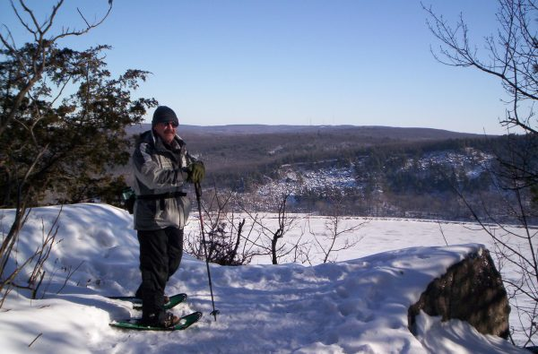 The author atop a rock cliff overlooking Devil's Lake.
