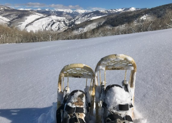 snowshoes overlooking mountains