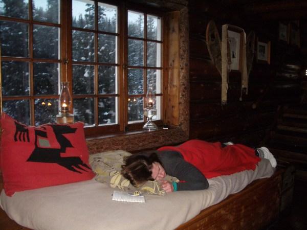 Taking a nap before dinner at Skoki Lodge
