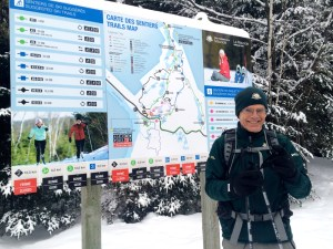 Parks Canada Guide beside trails map