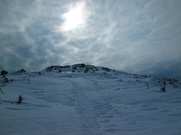 Winter snow conditions make the long hike up Mount Marcy far more demanding. Photo Credit: Tim Moody