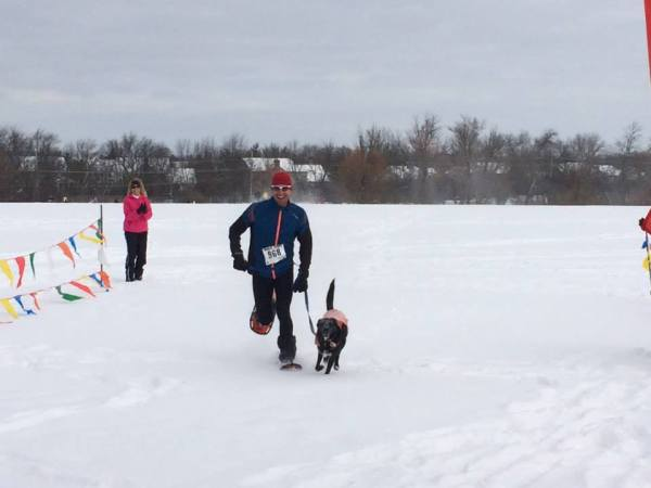 Brad Zoller with his training partner, Senna, last year in Barrington, IL for the Frozen Zucchini 5k snowshoe race.