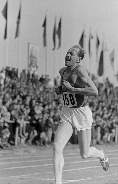 The incredible look of Zátopek in competition makes him easy to pick out on the track
