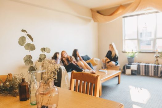 Group of Students sitting on couch inside dorm room