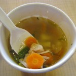 """Kentucky Fried Chicken soup in Indonesia. Chicken pieces and vegetables in chicken broth soup. This kinds of soup actually a typical Indonesian """"sayur sop"""" (chicken vegetable soup), contains chicken, carrot, potato, green bean, onion and celery."""