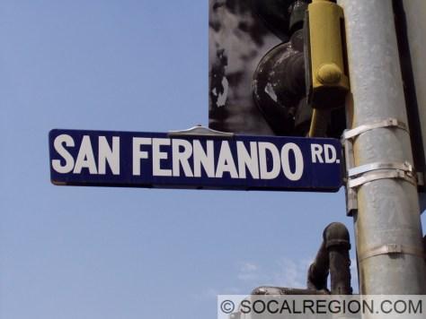 Older porcelain enamel San Fernando Road sign at Newhall Avenue.