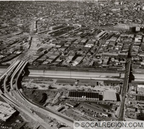 Oblique aerial view westerly along under-construction I-10 Santa Monica Viaduct. Photo was taken by the Division of Highways on December 7, 1960. Bridges over the Los Angeles River were completed earlier in 1959 in a separate contract.