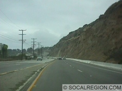 Typical section with cliffs and a temporary barrier to block rockslides.