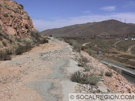 Section of alignment just west of the summit. This was realigned in 1953 when passing lanes were added. The cut on the right was for a realignment of the railroad around 1996.