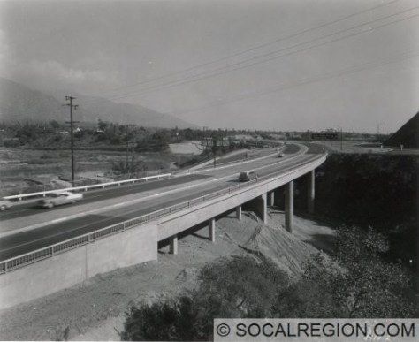 View looking southeasterly from the Linda Vista bridge. This segment of the old freeway is still in use and intact. The new Foothill Freeway (I-210) runs to the right of the old freeway.