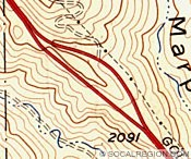 About 2/3 up the grade, the highway split for a short distance as this map shows. The roadway to the right is the 1933 alignment and to the left is the 1948 widening. When Five Mile Grade was redone as a freeway, the split was removed and the new roadway took the 1948 side. The 1933 side was then buried and torn up.