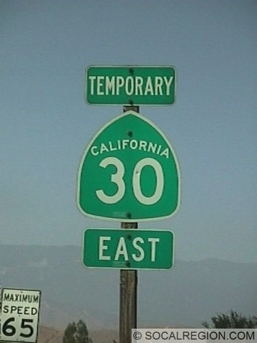 Temporary banner above State 30 shield at the present terminus of the eastern segment of the freeway. This is the only temporary banner in use in California.