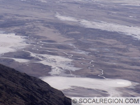 Well defined and sinuous channel of the Amargosa River approaching Badwater Basin.