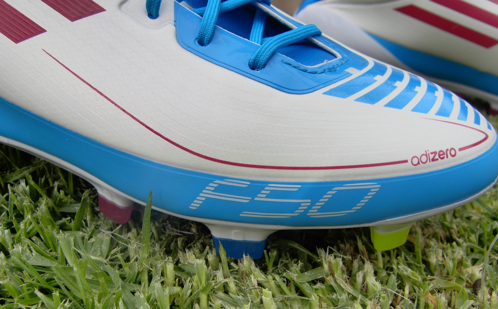 f113a7277b5 ... trx fg cleats lightning white radiant pink cyan White Cyan F50 adizero  Spec  Adidas F50 adiZero Prime up close . ...