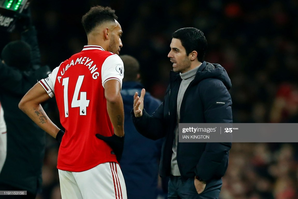 Arsenal's Spanish head coach Mikel Arteta (R) speaks with Arsenal's Gabonese striker Pierre-Emerick Aubameyang (L) during the English Premier League football match between Arsenal and Manchester United at the Emirates Stadium in London on January 1, 2020. (Photo by Ian KINGTON / IKIMAGES / AFP) / RESTRICTED TO EDITORIAL USE. No use with unauthorized audio, video, data, fixture lists, club/league logos or 'live' services. Online in-match use limited to 45 images, no video emulation. No use in betting, games or single club/league/player publications. (Photo by IAN KINGTON/IKIMAGES/AFP via Getty Images)