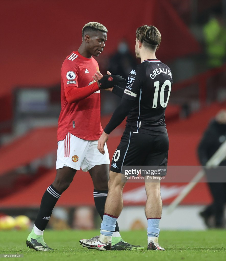 Manchester United's Paul Pogba (left) shakes hands with Aston Villa's Jack Grealish after the Premier League match at Old Trafford, Manchester. (Photo by Carl Recine/PA Images via Getty Images)