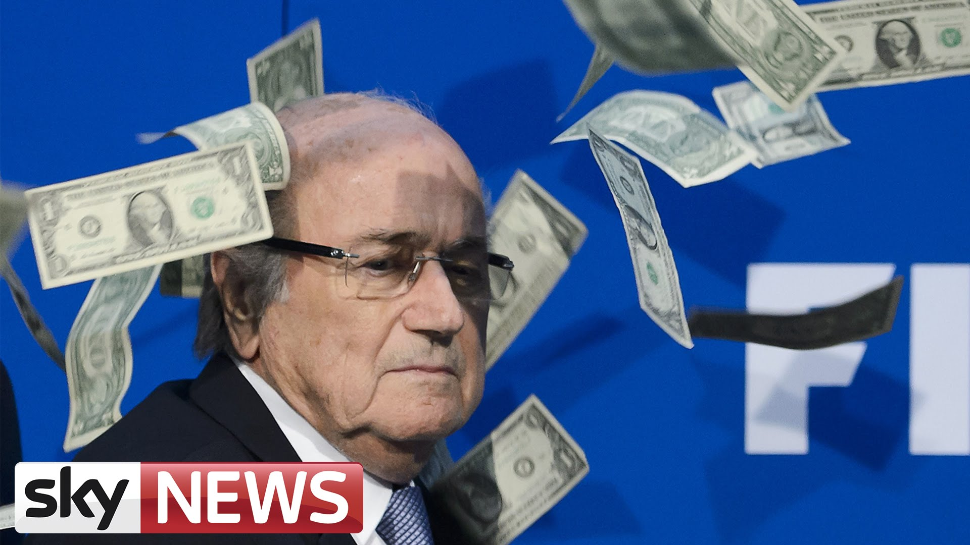 Comedian Simon Brodkin showers FIFA President Sepp Blatter with cash