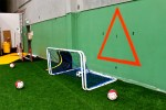 The triangle makes the player more precise on high passes as the higher you go, the smaller the target.