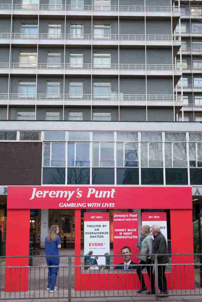 NHS junior doctors erect a faux betting shop storefront,