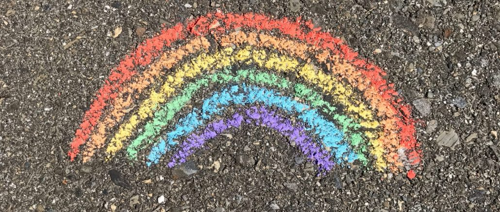 Rainbow in chalk on pavement