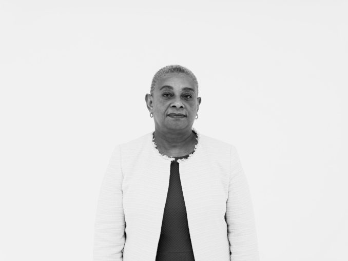Black and white image of Doreen Lawrence looking directly at the camera.