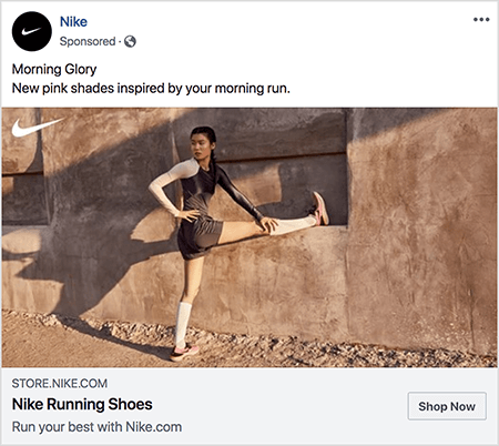 """This is a Facebook ad for Nike running shoes. The ad text says """"Morning Glory"""" and on the next line """"New pink shades inspired by your morning run."""" In the ad photo, an Asian woman is stretching with one leg extended straight out and her foot on a ledge and her other foot on the ground. Her upper half is twisting to the side. She's wearing pink Nike running shoes, white knee socks, and dark gray running shorts and a tank top. Her hair is pulled up. She's on a dirt path in front of a stucco- or earthen-looking building. Talia Wolf says Nike is a great example of a brand that uses emotion in advertising."""